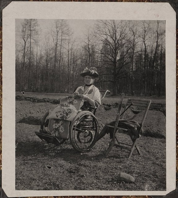 Russian Empress Alexandra Fyodorovna in a wheelchair during the royal family's detention in Siberia,1918