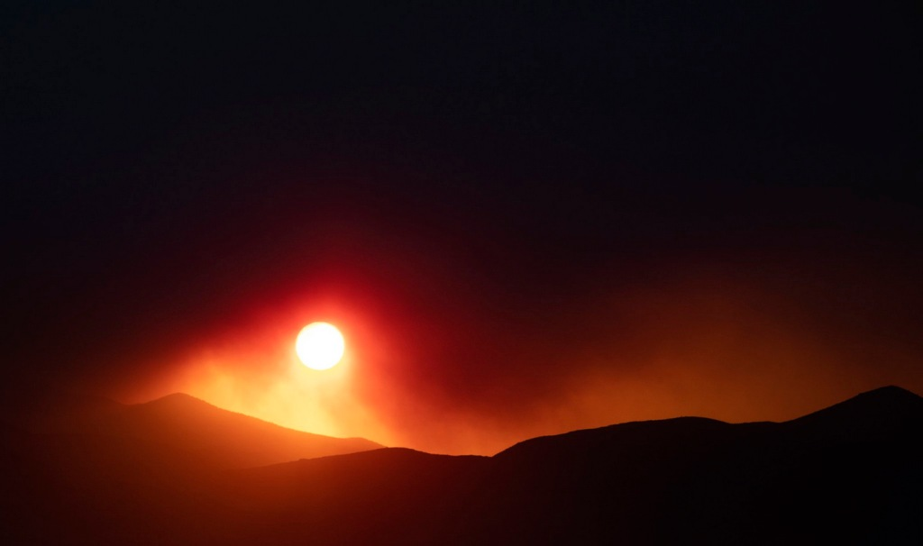 Sunset over a forestfire