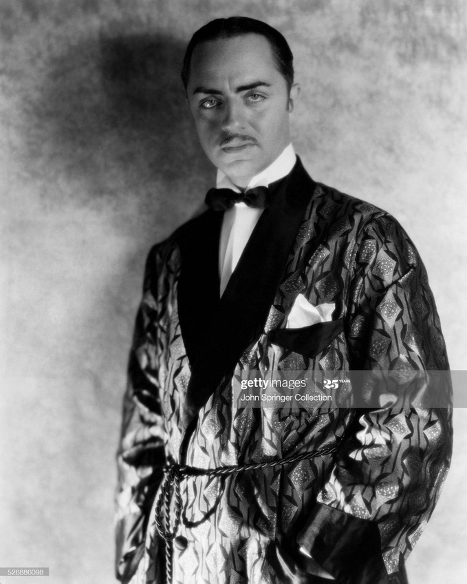 William Powell, wearing a smoking jacket, 1930s