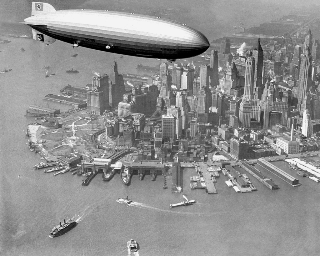 The Hindenburg flying over lower Manhattan, NYC, 1930s