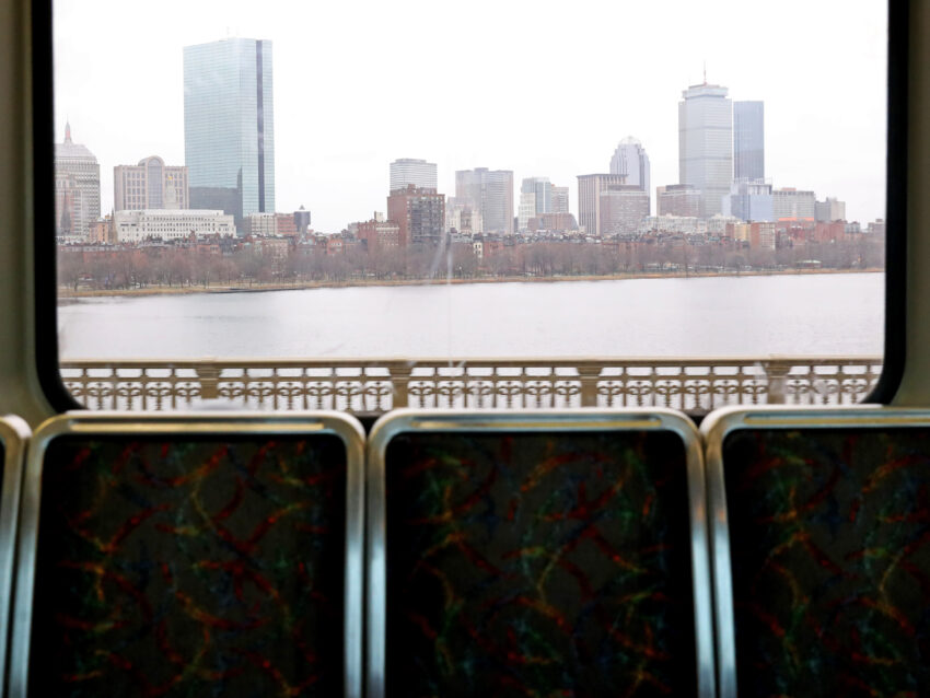 The Back Bay section of Boston as seen from a subway car going over a bridge over the Charles River