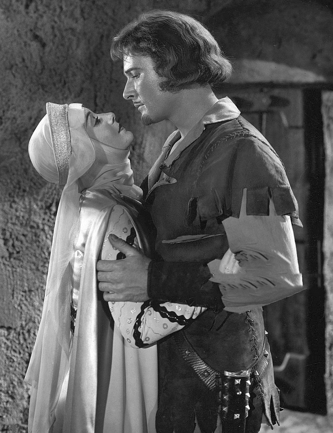 "Olivia DeHaviland and Errol Flynn in ""Robin Hood"""