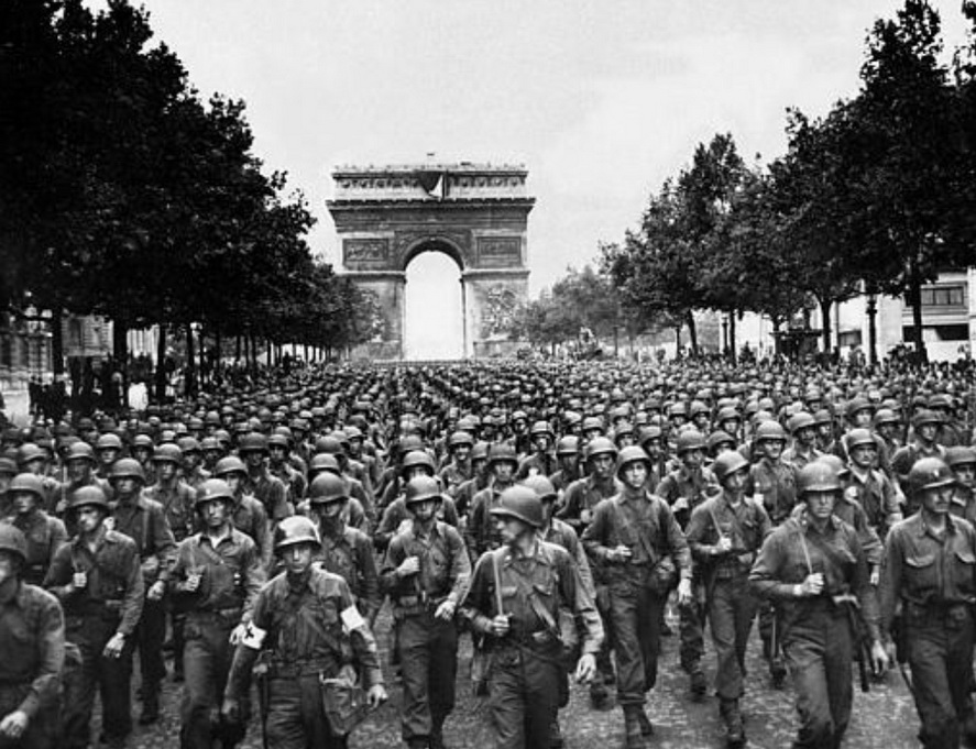 American and allied troops marching in Paris to celebrate the city's liberation from the Nazis, August, 1944