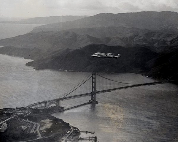 Amelia Earhart heading out of San Francisco over the newly completed Golden Gate Bridge