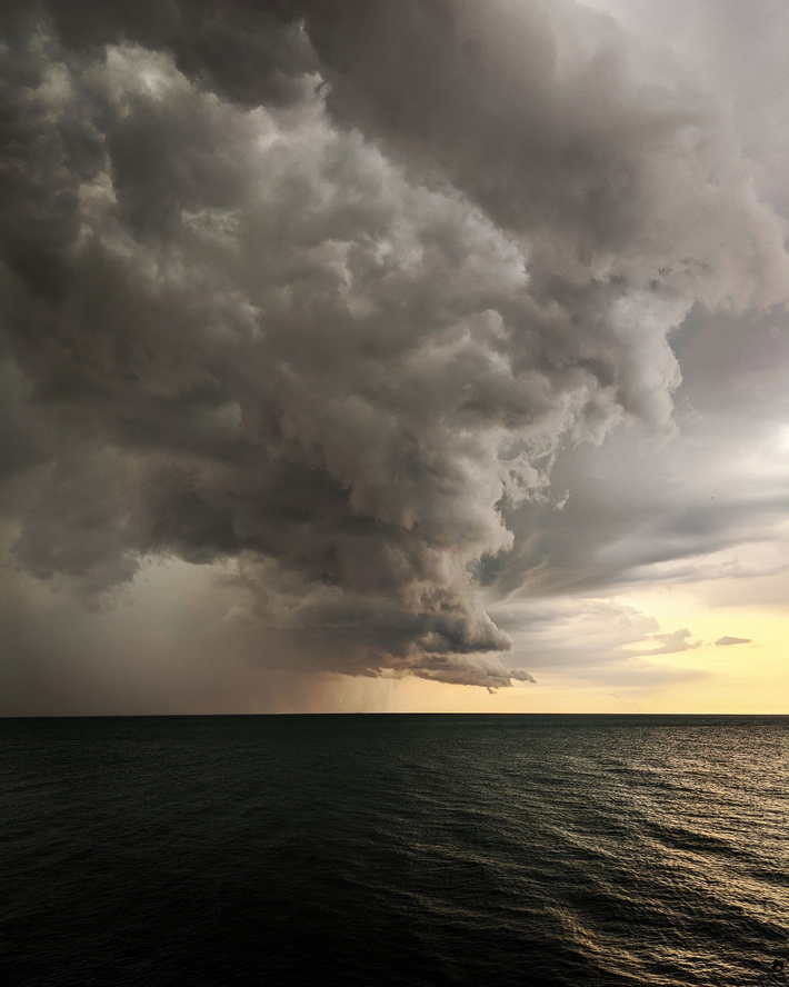 Storm clouds over water