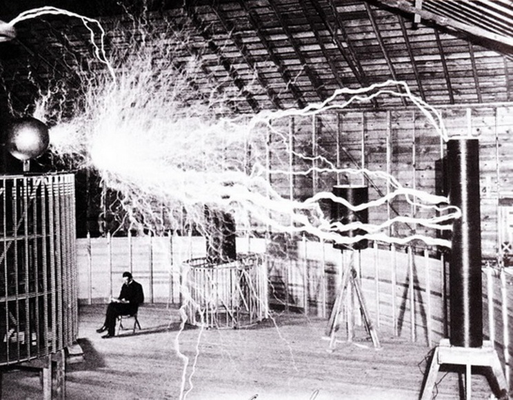 Tesla in his laboratory, doing electrical things