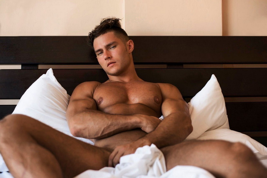 Russian model Anatoly Goncharov in bed
