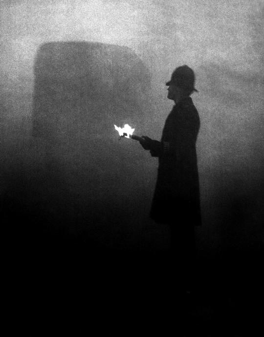 London policeman in daytime directing traffic during the Great Smog of1952