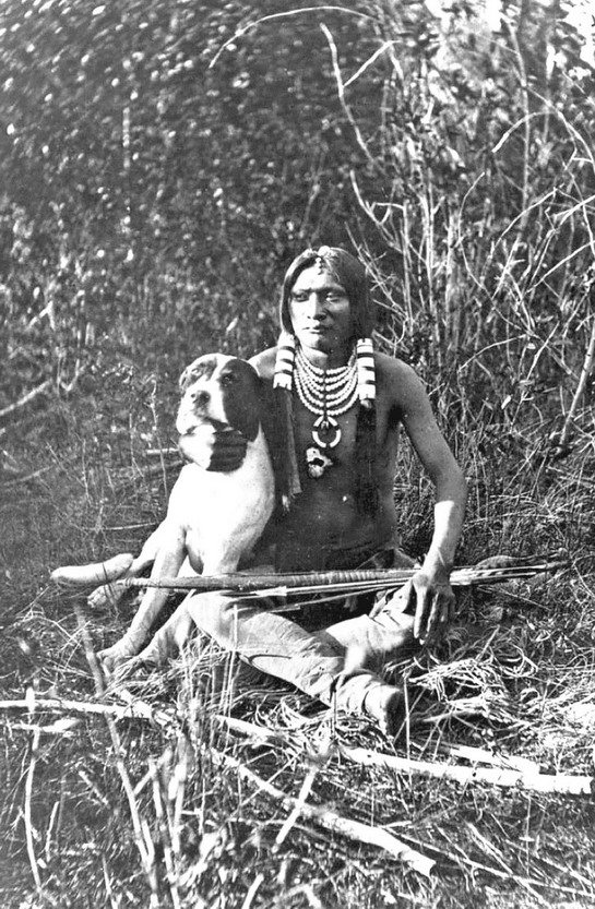 Native North American hunter and his dog