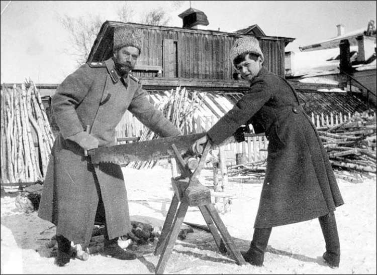 Tsar Nicholas II and son cutting up firewood while being held captive by the Bolsheviks in Siberia,1918