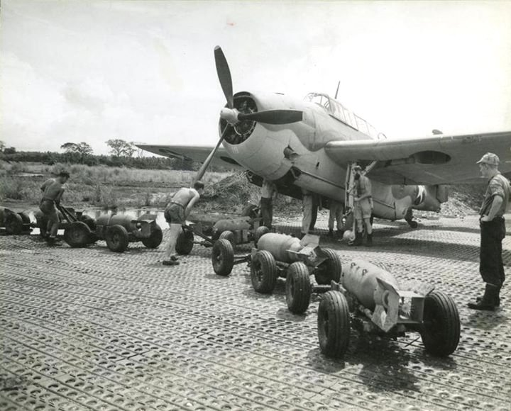 US soldiers loading bombs onto a plane in the South Pacific, WWII