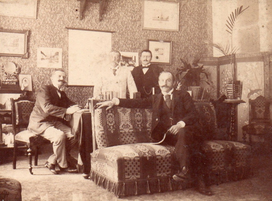 Four mustachioed men together in a salon,1800s