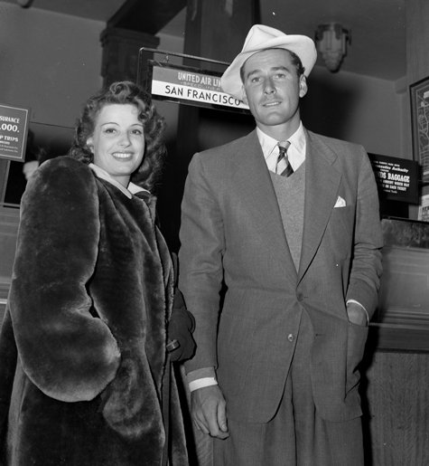 Errol Flynn and his wife at the time, Lili Damita, at an airport, 1930s