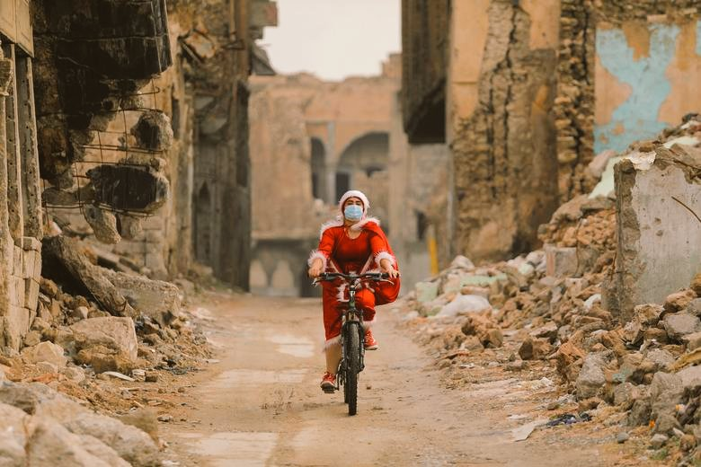 Kurdish activist Shaimaa al-Abbasi takes on the role of Santa, brings joy and gifts to children in Mosul, Iraq, 2020