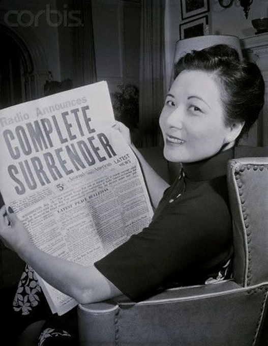 Madame Chiang Kai-Shek reading the news of the Japanese surrender in WWII, 1945