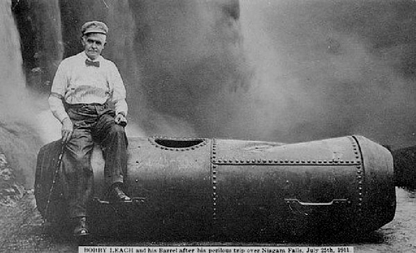 Bobby Leach sitting on the steel barrel he used to survive a plunge over Niagara Falls in 1911