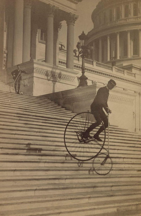 Riding a penny farthing backwards down the steps of the US Capitol, Washington DC,1884