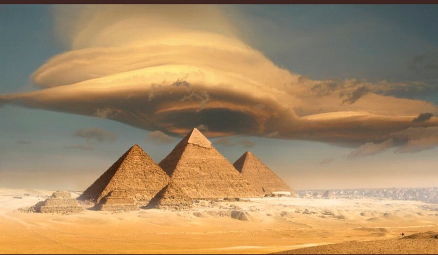 The Great Pyramids of Egypt with a lenticular cloud overthem