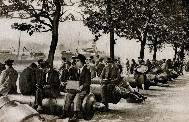 Office workers having lunch along the Thames, London, 1920s