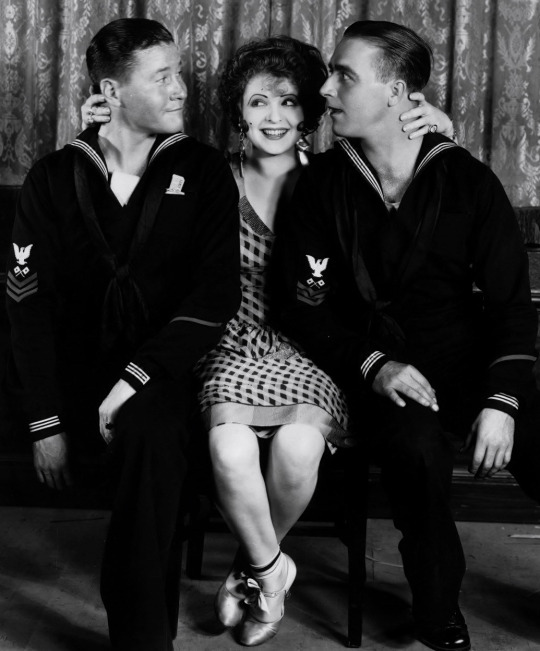 Silent film star Clara Bow with two sailors