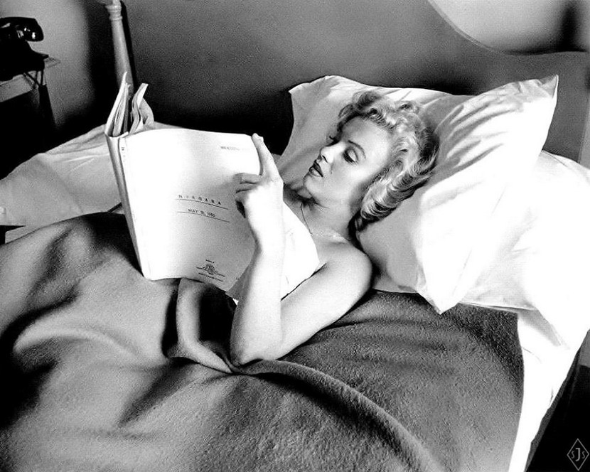 "Marilyn Monroe in bed reading the script for ""Niagara"""