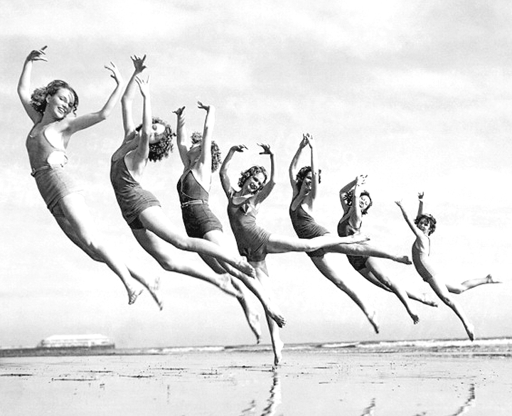 Dancers in bathing suits at the beach, circa 1930