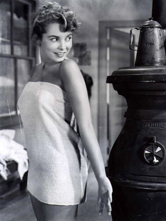 Janet Leigh warming up by awoodstove