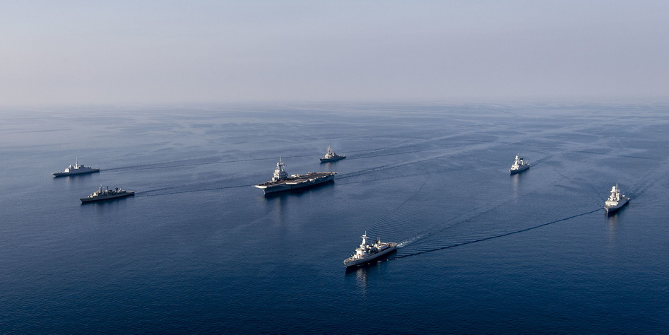 A NATO carrier group on patrol in calm seas, 2021