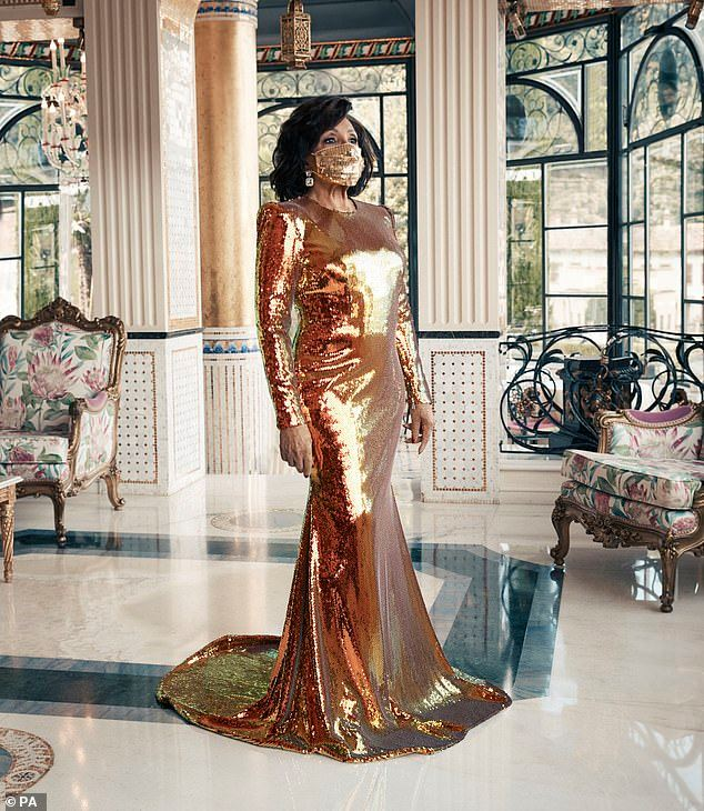 Dame Shirley Bassey showing us you can still be elegant wearing amask