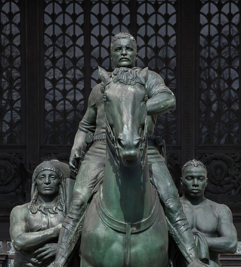 Teddy Roosevelt and people he subjugated (African Americans and Native Americans), since removed from outdoor publicdisplay