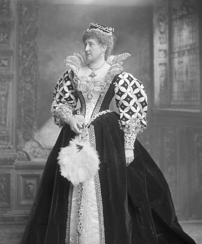 Woman dressed in period costume for the Devonshire House Ball of1897