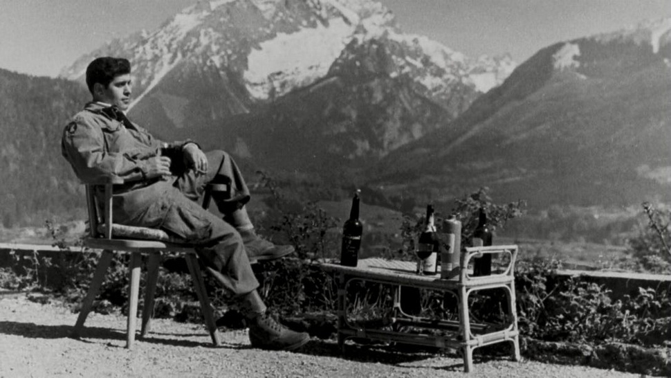 American soldier sitting at Hitler's house in the Bavarian Alps, drinking Hitler's cognac, after the Allied invasion of Germany,1945