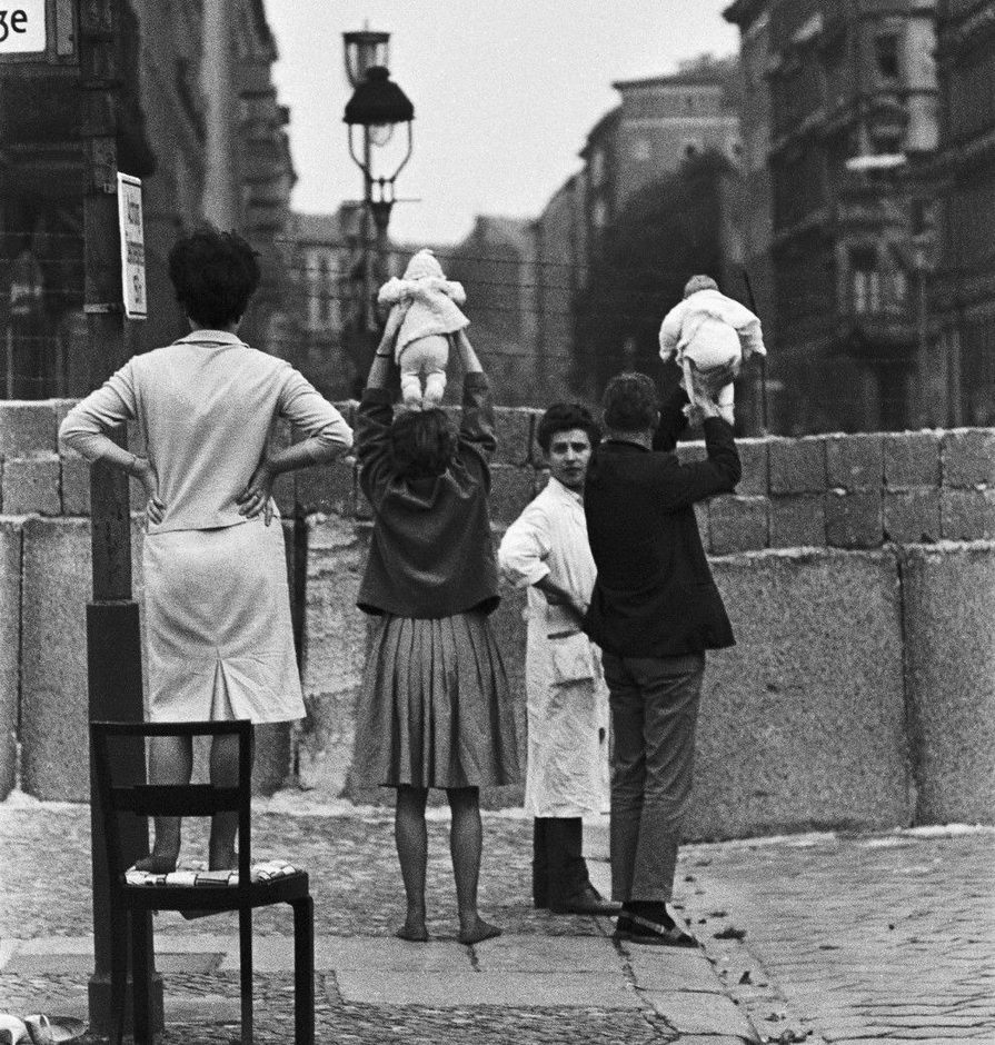 Talking to relatives in East Berlin over the Berlin Wall,1960s