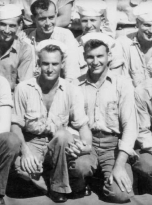 Sailors together, holdinghands