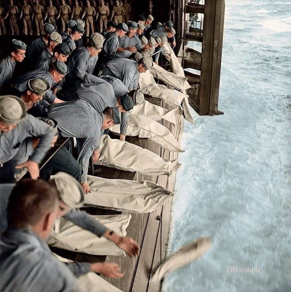 Mass burial at sea after a Japanese kamikaze attack on a US warship,WWII