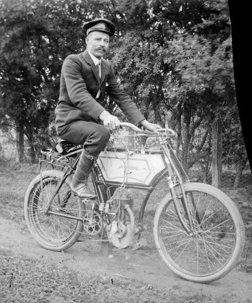 Man on a motorized bicycle, Australia, circa1900