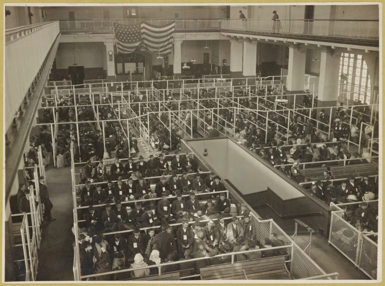 Immigrants arriving in the US at Ellis Island, NYC,1902