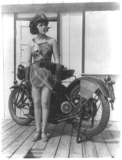 Silent film actress Elsie Tarron in a motorcycle cop bathing beauty pinup, circa1920