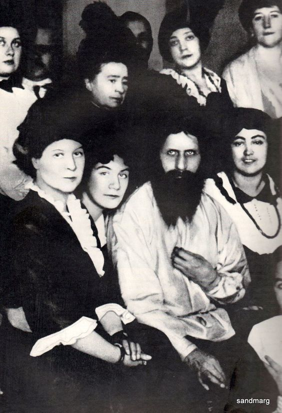 Rasputin, looking a little like Charles Manson, with some of his many femaleadmirers