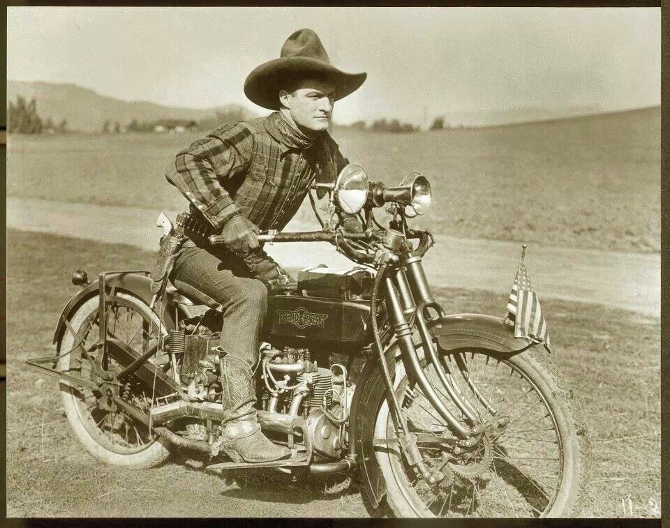 Actor Tom Mix on a motorcycle,1920s