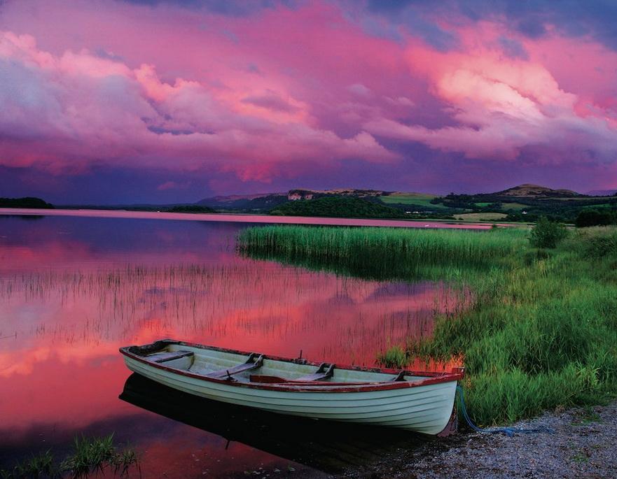 Rowing boat on a lake atsunset