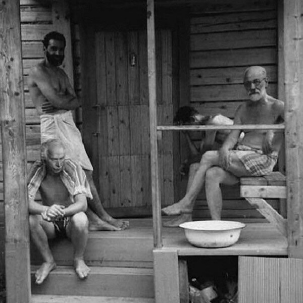 Shirtless Psychologists: Sigmund Freud, Karl Jung, and 2 others cooling off outside asauna
