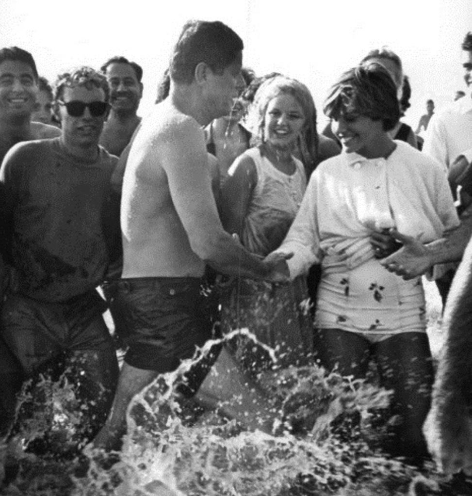 President Kennedy in wet shorts greeting voters in California, early1960s