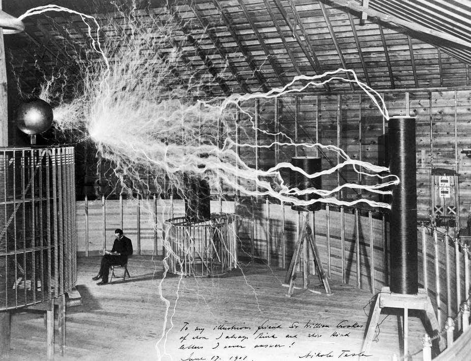 Nikola Tesla doing some electricalexperiments