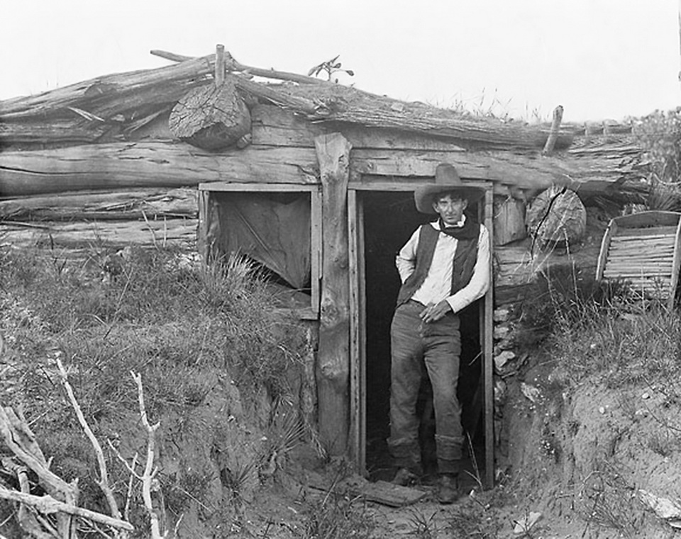 Cowboy and photographer of the Wild West in his dugout cabin,Texas