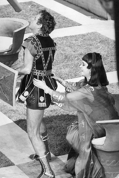"""Richard Burton and Elizabeth Taylor during a break in the filming of """"Cleopatra"""""""
