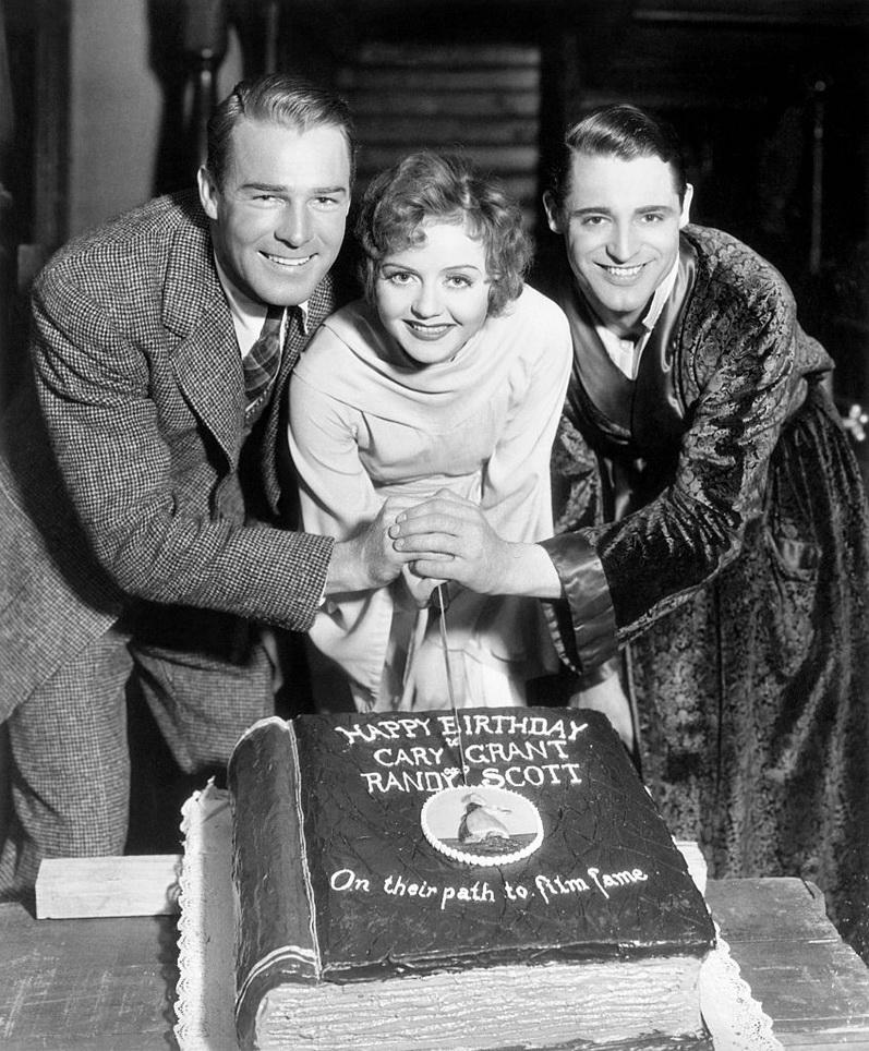 Cary Grant and Randolph Scott sharing a birthday cake,1932